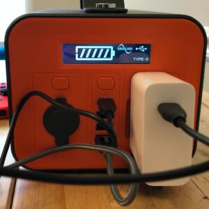 Novoo 230Wh Portable Power Station front panel, plugged in